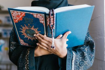 Holding Holy Qur'an